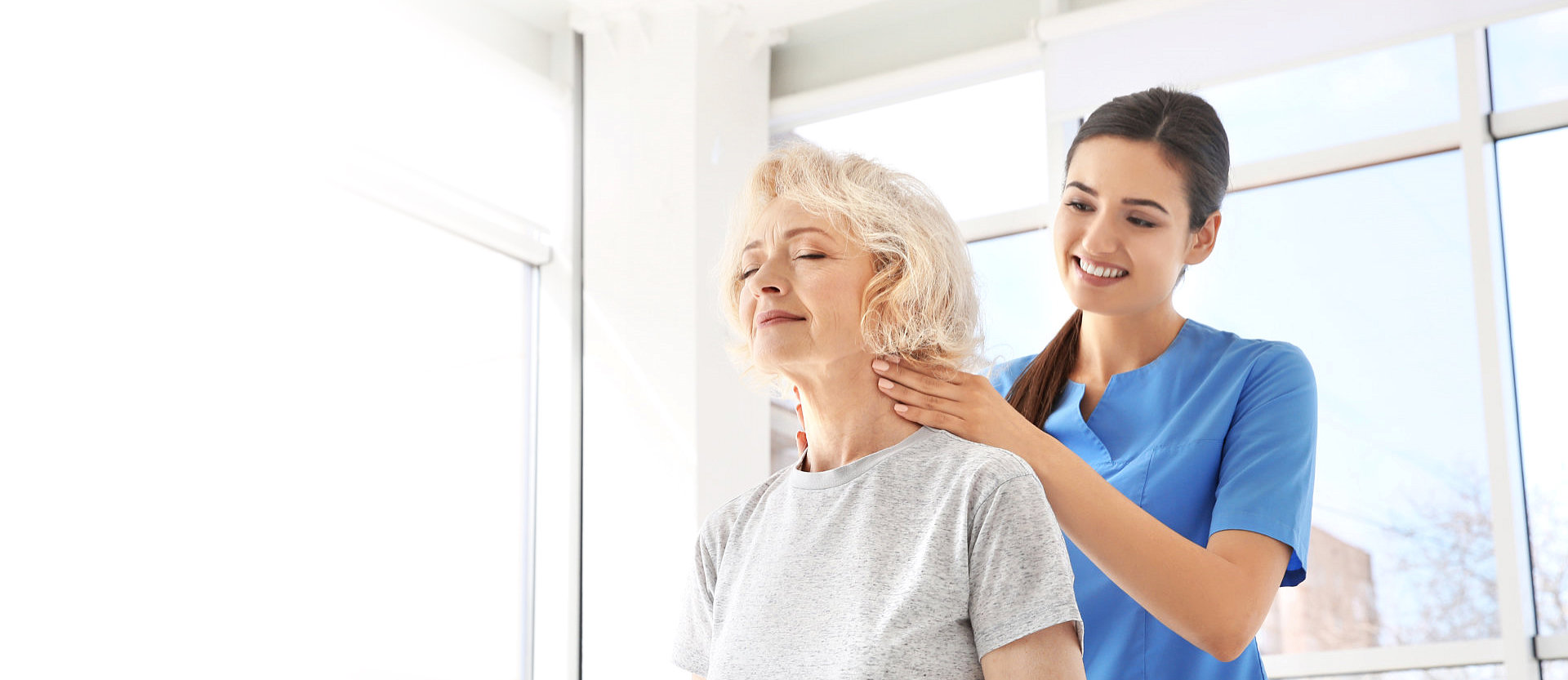 physical therapist serving senior woman