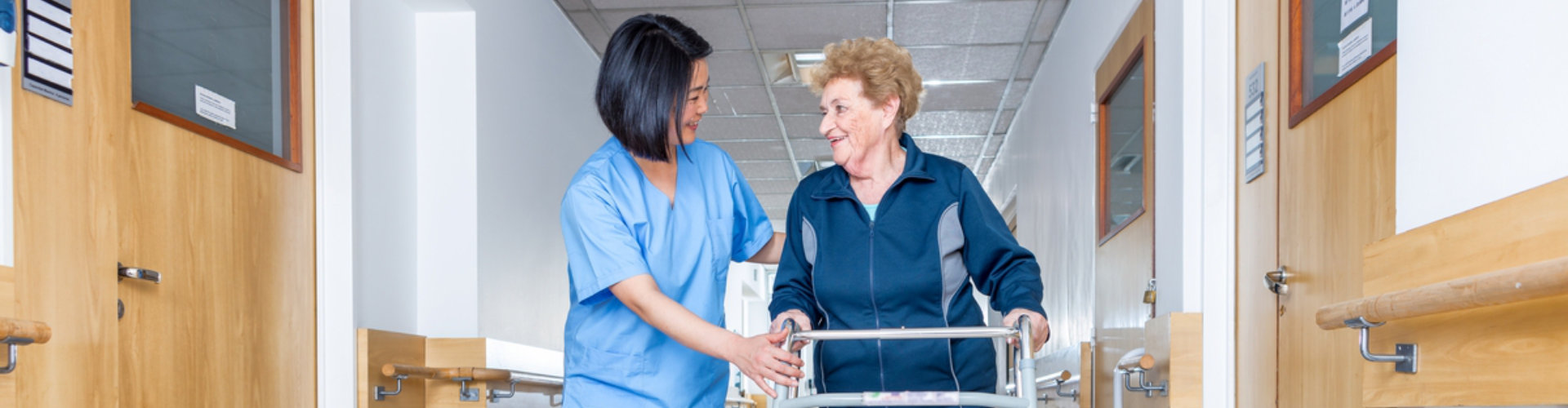 happy senior woman with physical therapist